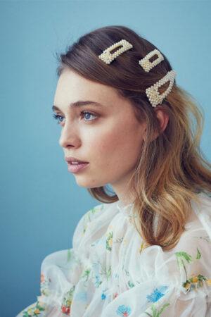 Las horquillas y los pasadores, los accesorios de pelo estrella para novias e invitadas.
