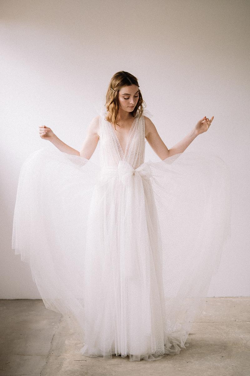 Vestido de novia flowy de plumeti de Ramón Herrerías